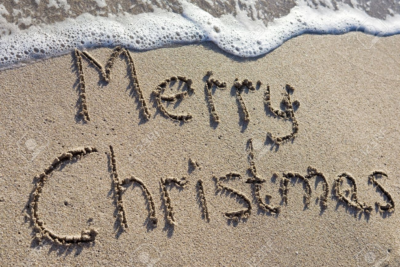 9962674-Merry-Christmas-written-on-the-sand-Stock-Photo-summer